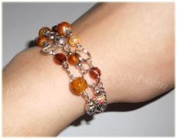 Brązowa bransoleta z łańcuszkami