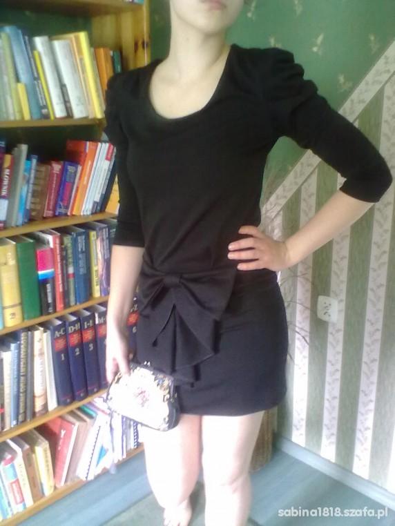 Eleganckie sukienka z bufkami i kokardą