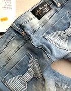 Spodnie zkokardkami BLUE RAGS...