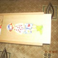 Drewniana układanka w pudełku clauny