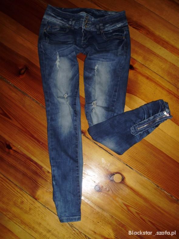 zipy spodnie dziury 38 M