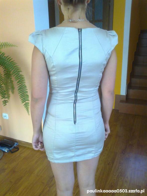 Suknie i sukienki z zipem