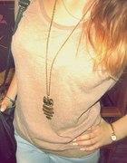 brązowy swetere
