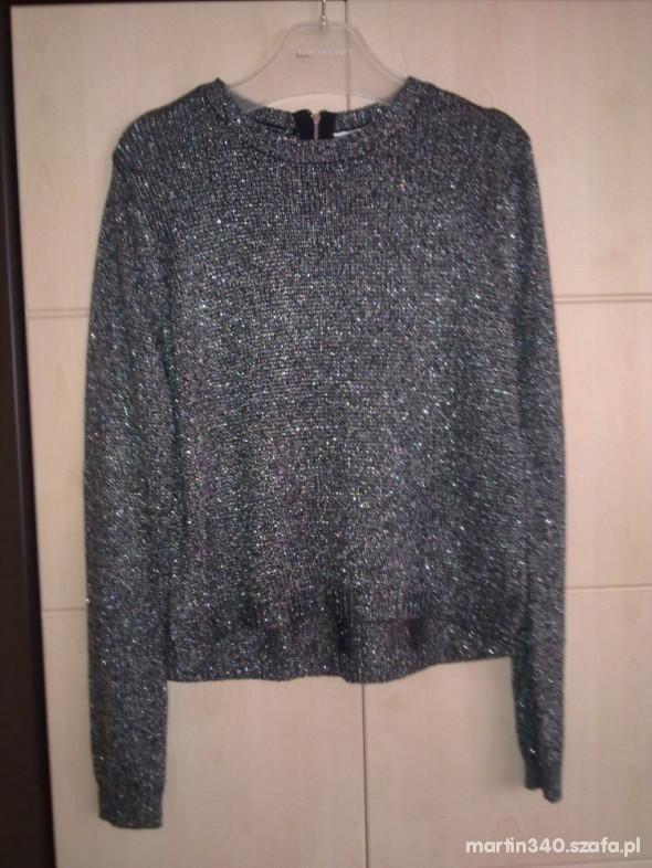 Metaliczno srebrny sweter zip