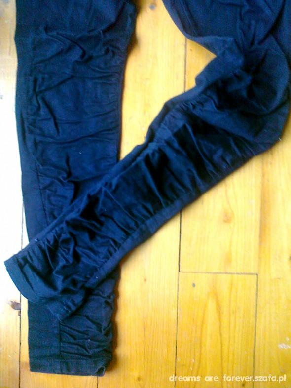 Spodnie Mega rurki marszczone rozm 40