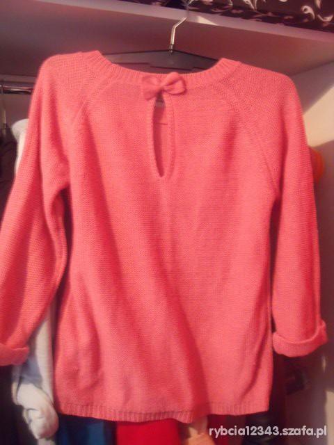 Różowy sweter Reserved z kokardką...