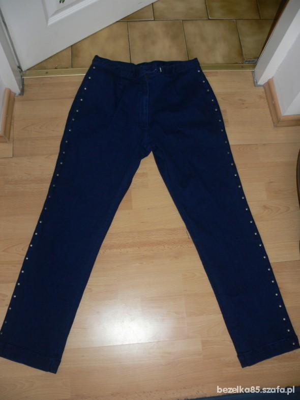 Spodnie jeansy 42 ćwieki