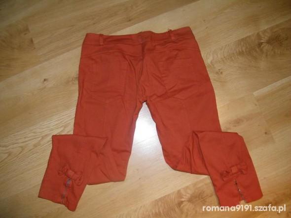 Spodnie pomarańczowe z kokardkami i zamki