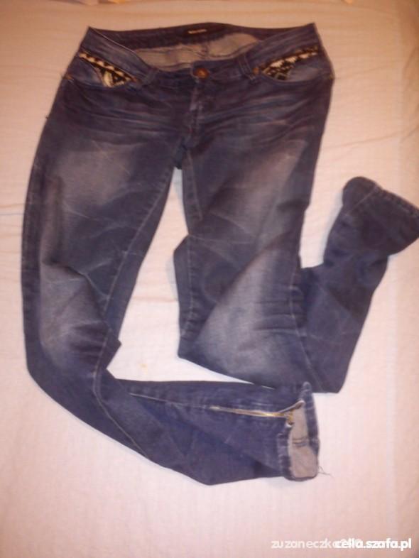 Spodnie granatowe rurki z zipami