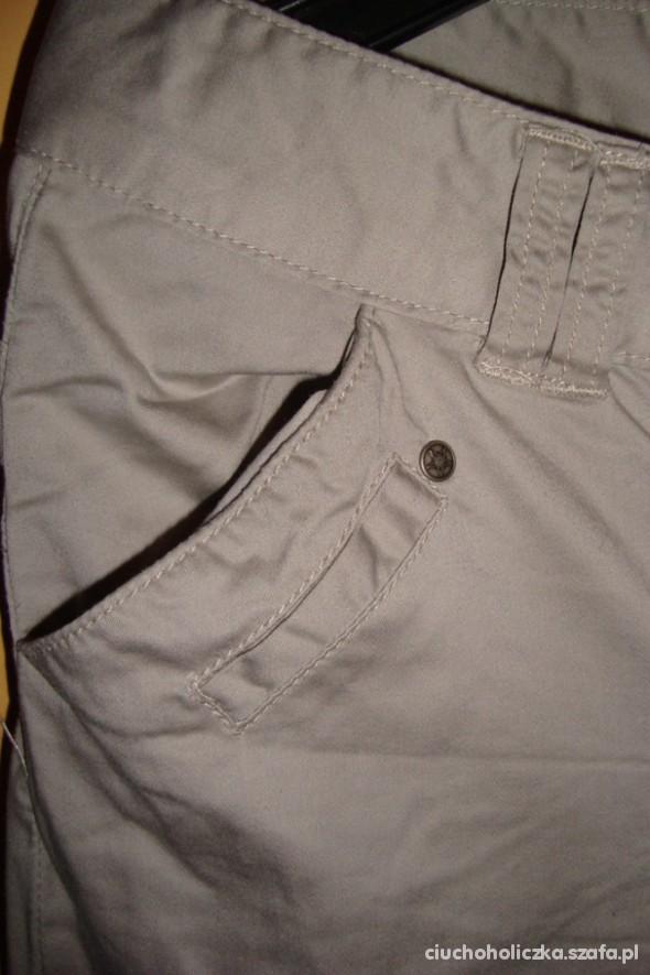 Spodnie Beżowe proste spodnie Troll 38 M