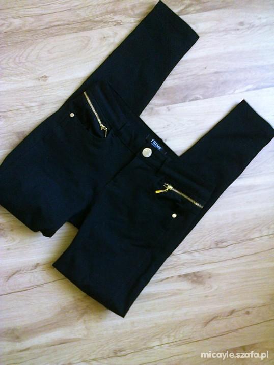Spodnie czarne tregginsy ze złotymi zipami