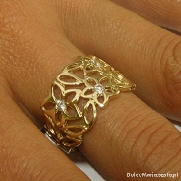 Ażurowy złoty pierscionek...