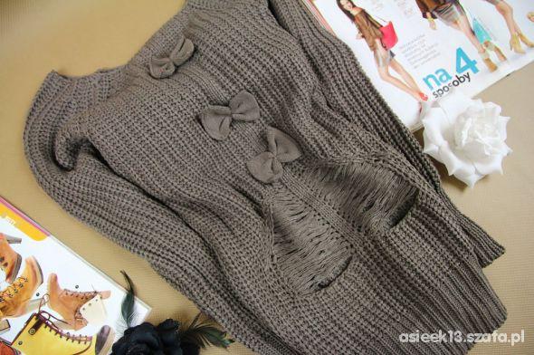 Sweter z kokardkami