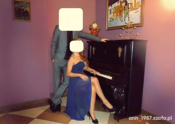 Wieczorowe Elegancka sukienka z dłuższym tyłem