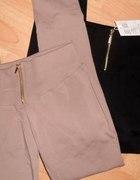 czarne oraz beżowe legginsy złoty zip