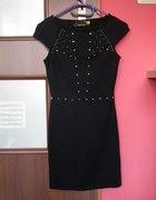 Czarna sukienka z ćwiekami...