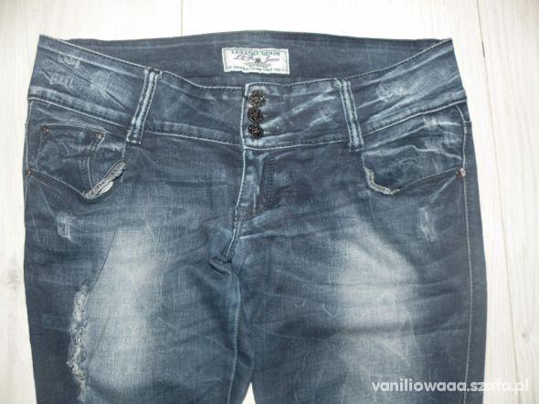 Spodnie jeansy dziury xl xxl jak nowe cena z przesyłką
