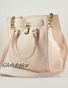 pudrowo różowa torba ze złotą kłódką...