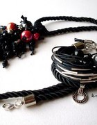 czarna drapieżna biżuteria z metalem wisior...