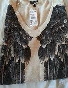 Sweter ze skrzydłami...