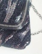 Elegancka ozdobna torebka zdobiona suwakiem