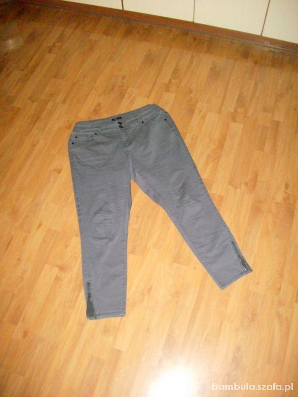 Spodenki Jeansy z elastanem zameczki 48 50