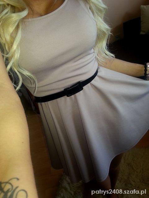 Rozkloszowana sukienka z paskiem S