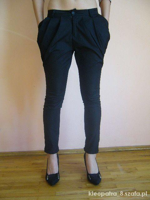 Czarne spodnie z zakładkami elegancki 36