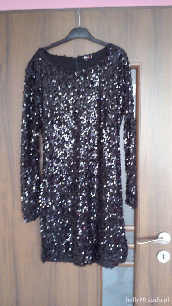 Czarna cekinowa sukienka z transparentnymi rękawam