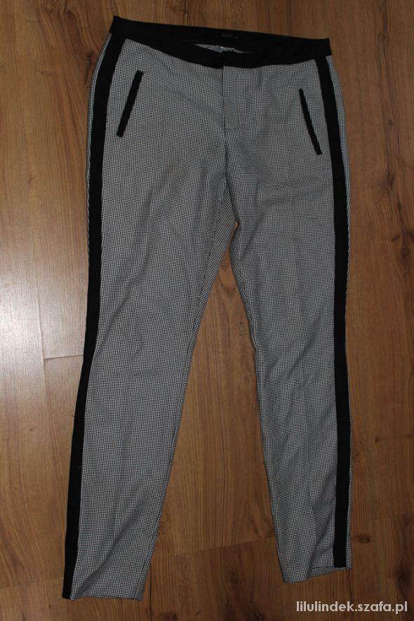 Spodnie Mohito w kratę 40