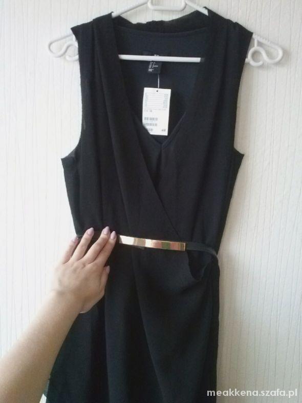 Czarna sukienka asymetryczna kopertowa midi XS w Suknie i