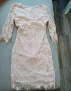 Nowa sukienka morelowego koloru