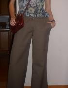 wełniane spodnie i delikatna bluzka razem...