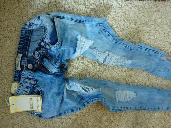jeansy marmurki przetarcia...