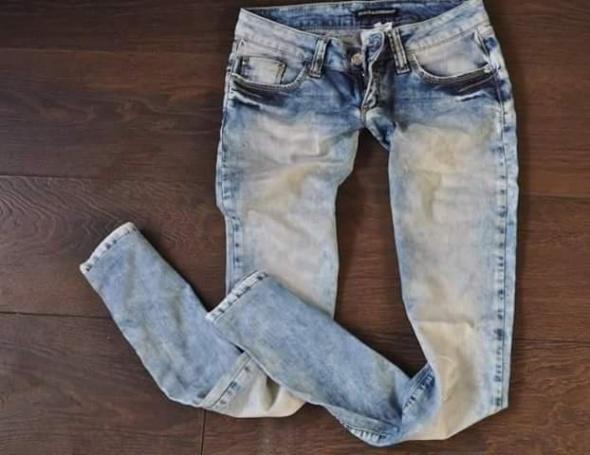 Ubrania D&G Dolce Gabbana spodnie jeansowe