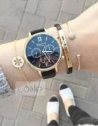 Czarny klasek geneva zegarek złote wykończenie