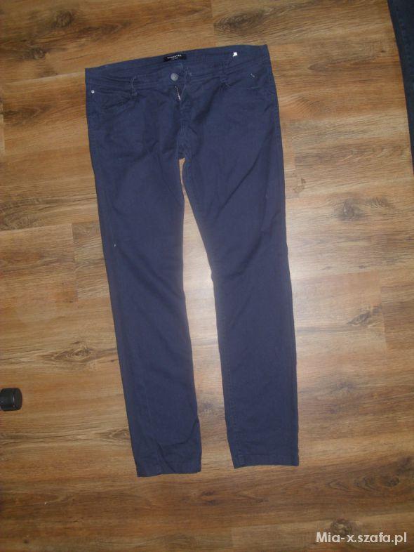 Granatowe spodnie biodrówki rozmiar 42...