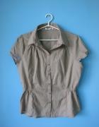 Beżowa bluzka z krótkim rękawem w stylu safari