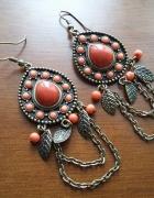 Kolczyki wiszące z pomarańczowymi oczkami...