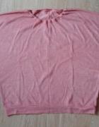 Różowy sweter