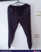 Czarne spodnie z zamkami Calzedionia...