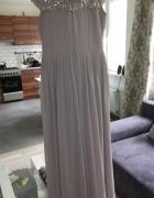 Piekna ekskluzywna suknia na specjalne okazje