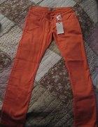 Pomarańczowe jeansy rurki NOWE z metką