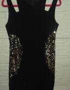 Czarna sukienka ze złotymi wstawkami z cekinów