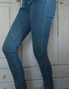 Świecące jeansy z Benetton