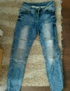 spodnie jeansowe marszczone na kolanach