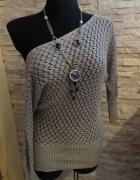 Ażurowy sweterek srebrny