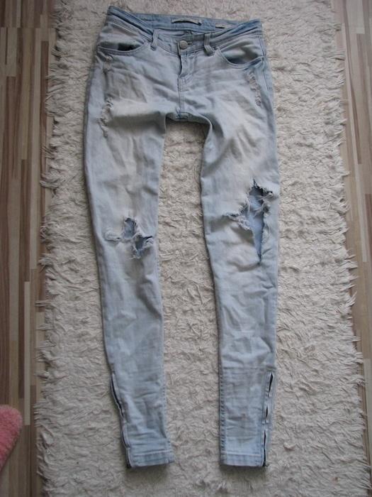 Spodnie Reserved jasny dżins dziury przetarcia zip
