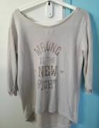 Beżowy sweter z ćwiekami