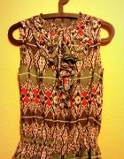 Wzorzysta bluzka bez rękawów z żabotem baskinką M...